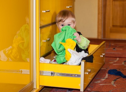 a 10-month-old boy playing in a drawer in April 2014