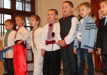 child boys performing in a Catholic kindergarten