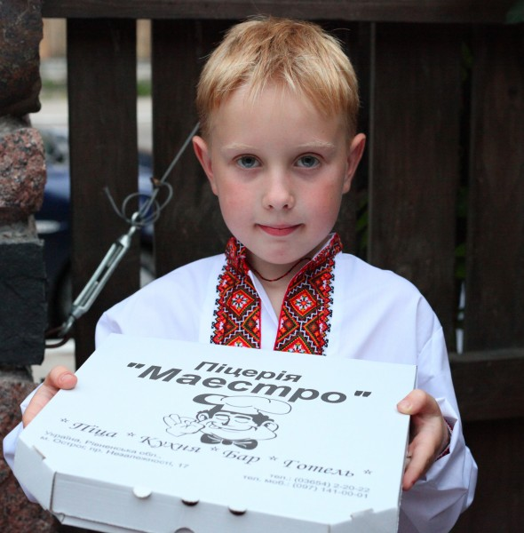 A boy with a box of pizza