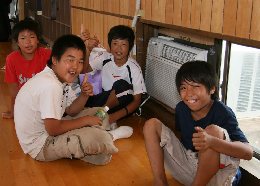 US Navy 070720-N-4270H-014 Four Japanese boys show their appreciation for the newly installed air conditioning units at the Arahama Community Center