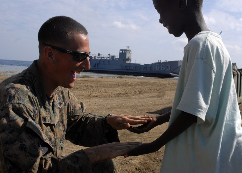 US Navy 100213-N-2000D-108 A Marine plays with a Haitian child