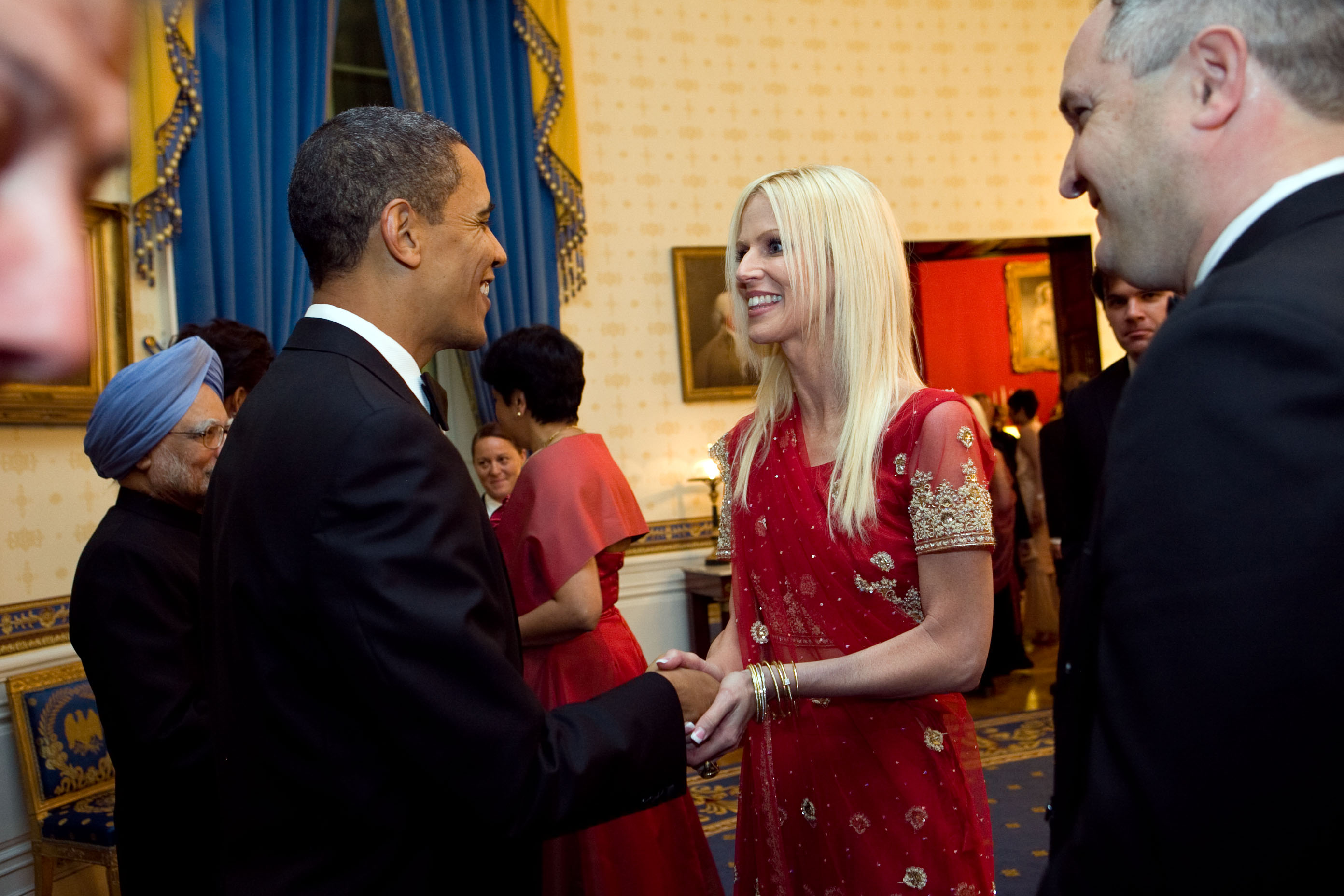 President Barack Obama greets Michaele and Tareq Salahi