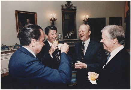 Photograph of the Four Presidents (Reagan, Carter, Ford, Nixon) toasting in the Blue Room prior to leaving for Egypt... - NARA - 198522
