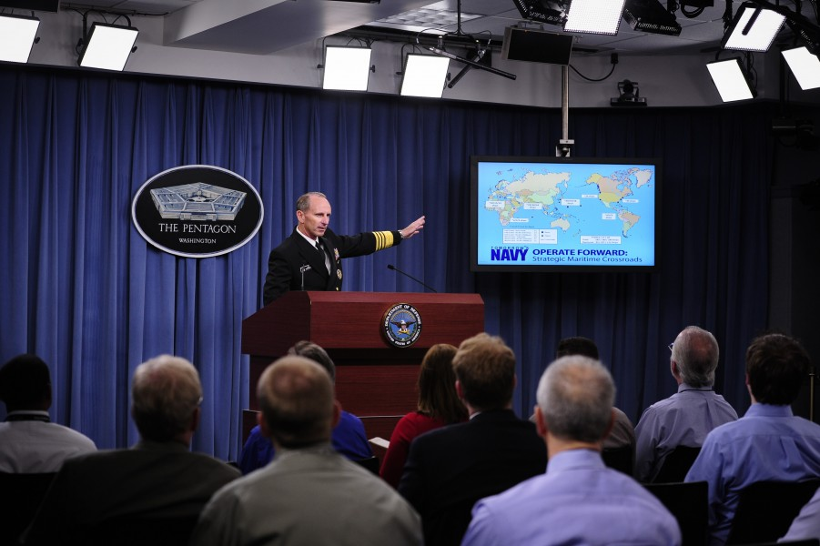 Defense.gov News Photo 120627-N-WL435-033 - Chief of Naval Operations Adm. Jonathan Greenert gestures toward a slide showing numbers and locations of ships as he talks to the media about the