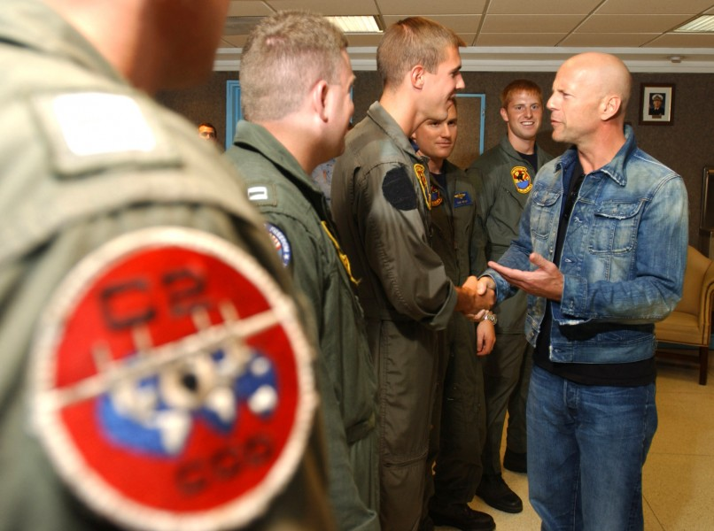 US Navy 020725-N-5319A-515 Actor Bruce Willis meets with Navy air crew