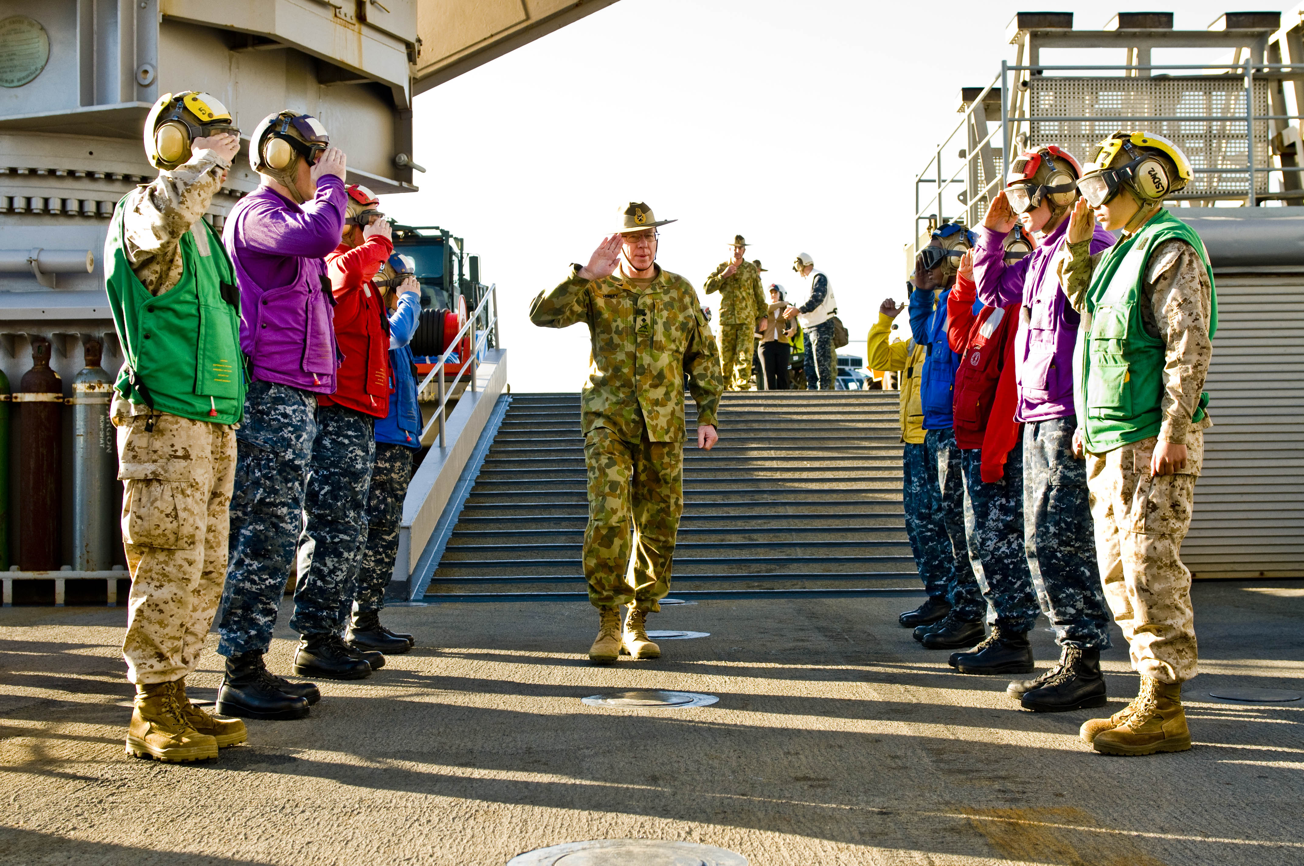 US Navy 110722-N-CZ945-090 Royal Australian Army Gen. David Hurley salutes rainbow sideboys upon his arrival aboard USS Germantown (LSD 42)