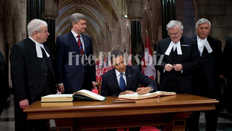Barack Obama signs Parliament of Canada guestbook 2-19-09