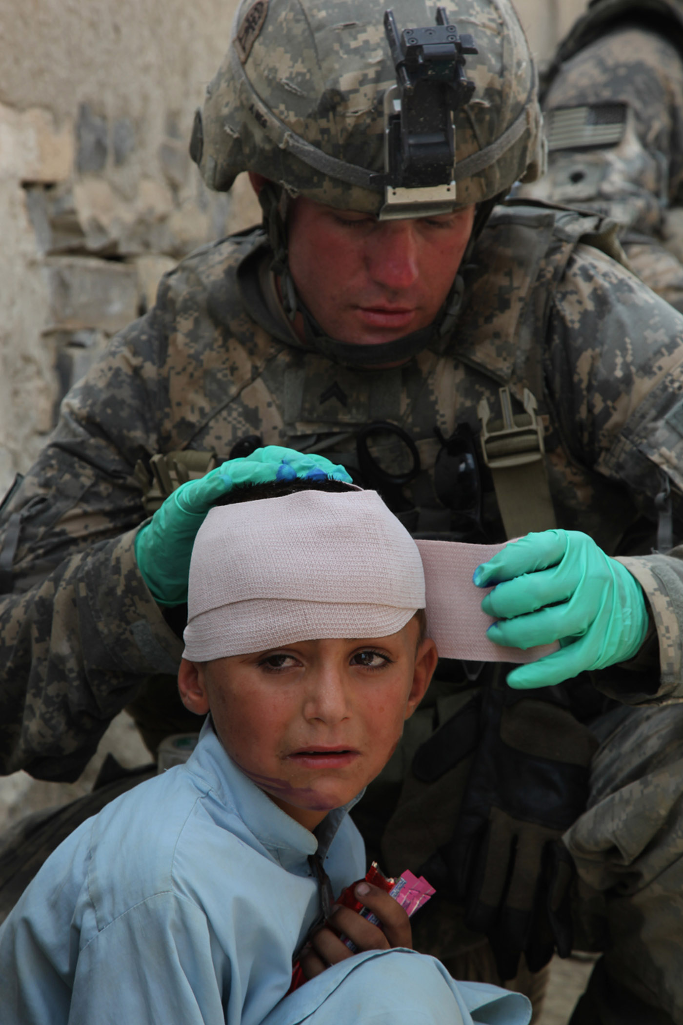 Afghan child's head wound treated...