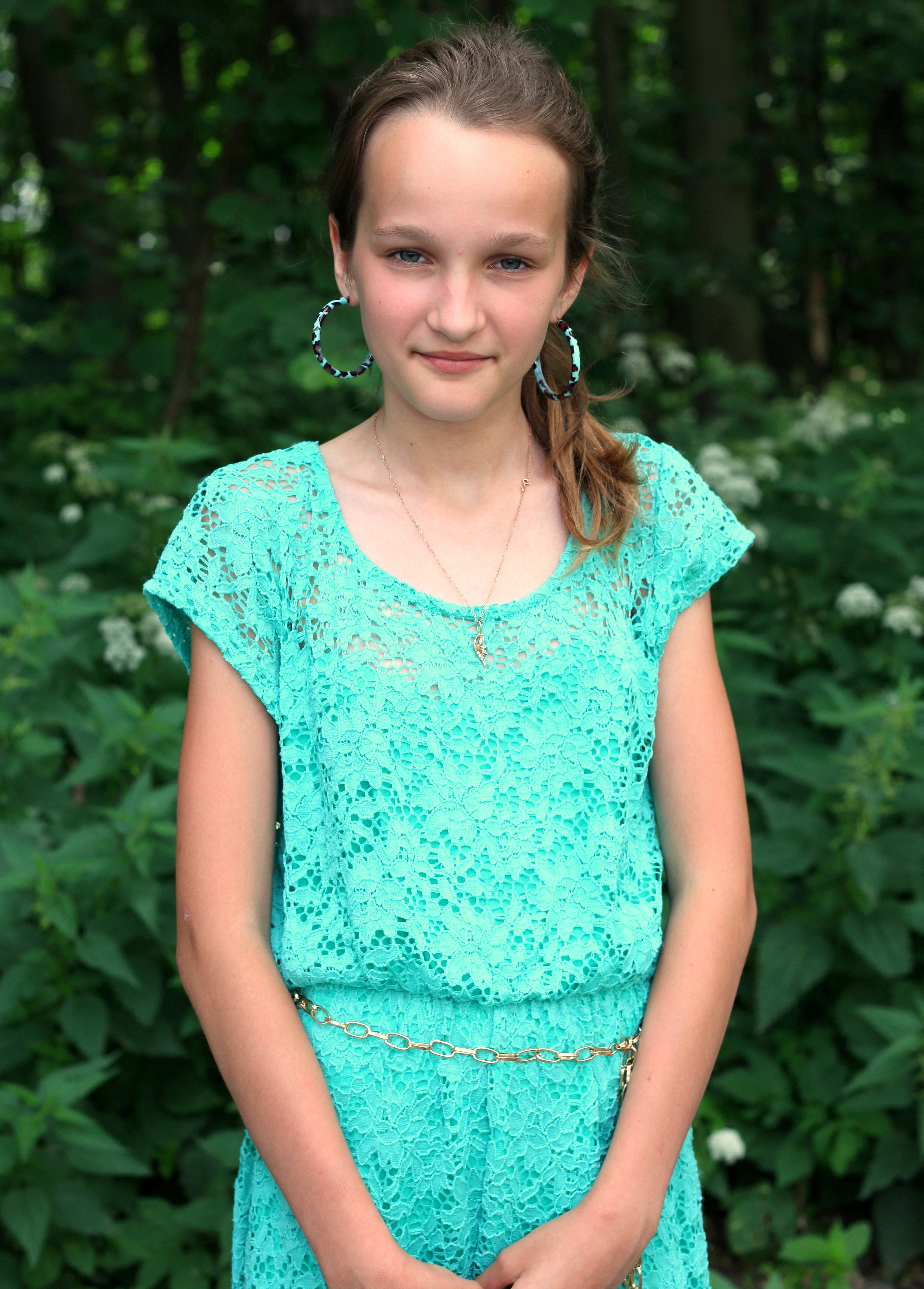 an absolutely beautiful girl with huge earrings, photographed in June 2013, portrait 2/27