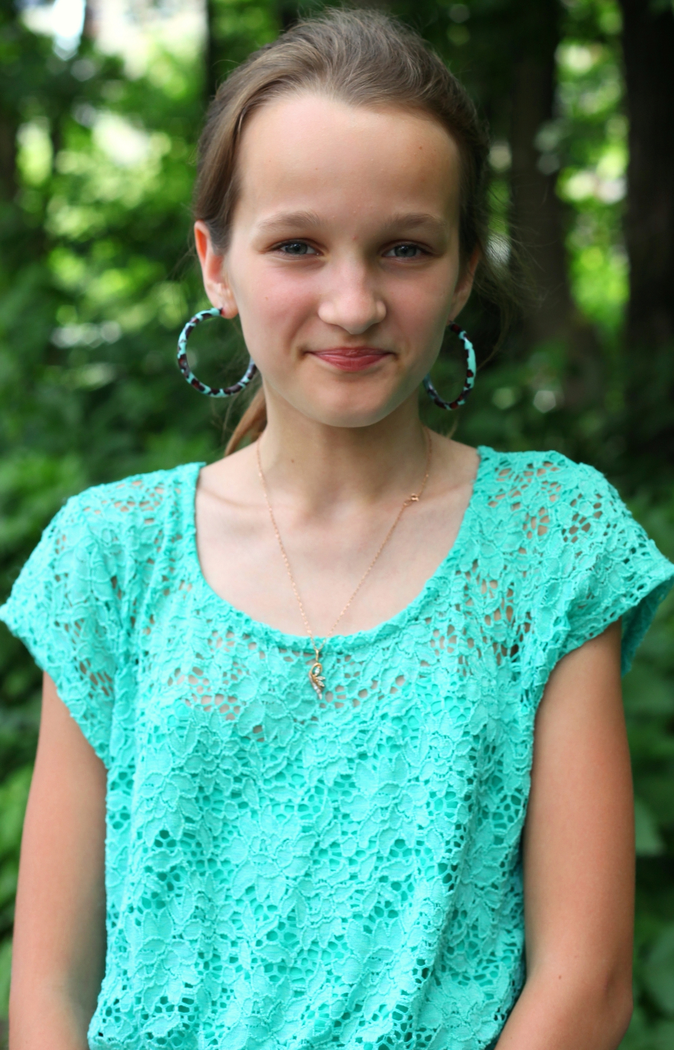 an absolutely beautiful smiling Catholic girl with huge earrings, photographed in June 2013, portrait 19/27