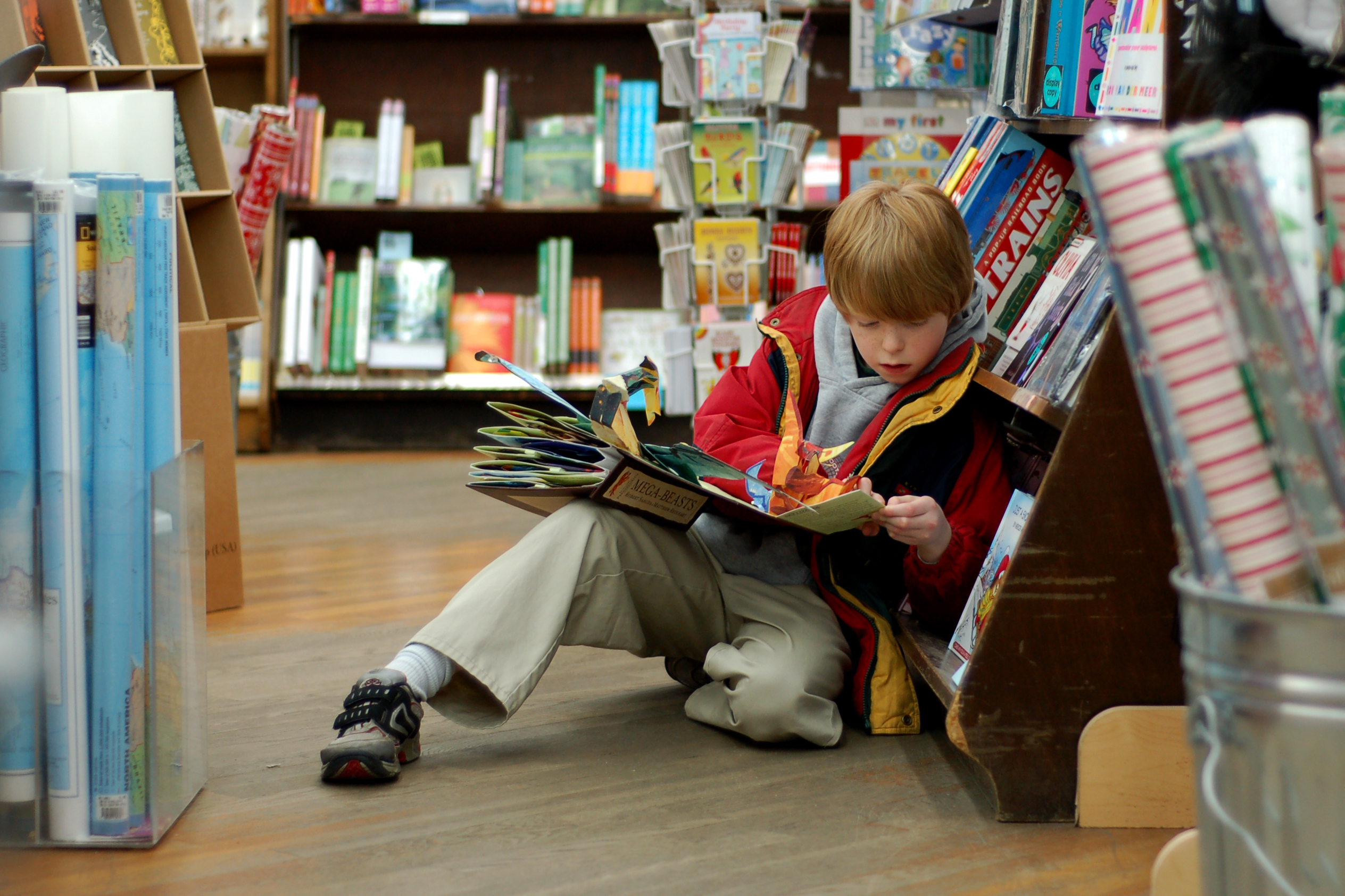 Child reading at Brookline Booksmith