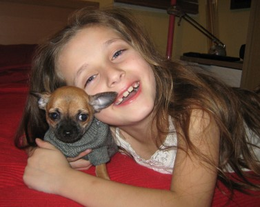 my daughter with her small puppy