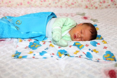a 6-day old baby boy sleeping, picture 2 out of 2, June 2013