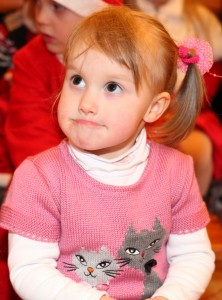 a cute Catholic baby girl at st Nicholas day celebration in a Catholic kindergarten, picture 6