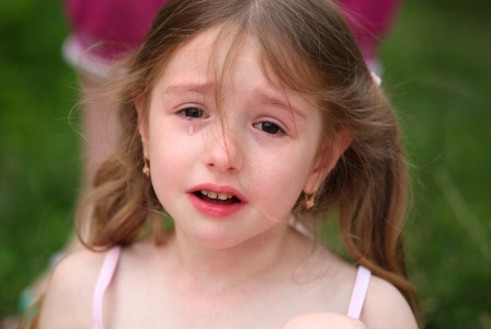 a cute brunette child girl crying, July 2013
