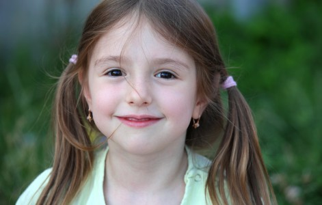 a really cute smiling brunette child girl in a Catholic camp in July 2013, portrait 7/7
