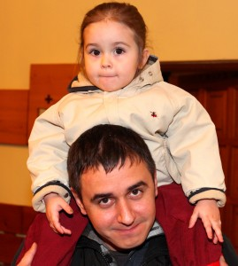 a Catholic father with his baby daughter at st. Nicholas day celebration in a Catholic kindergarten, picture 19