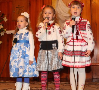 three cute child girls performing in a Church in a Catholic kindergarten, photo 2
