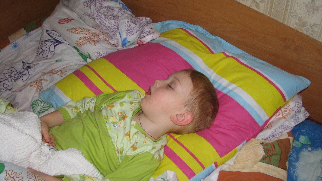 a small kid boy sleeping