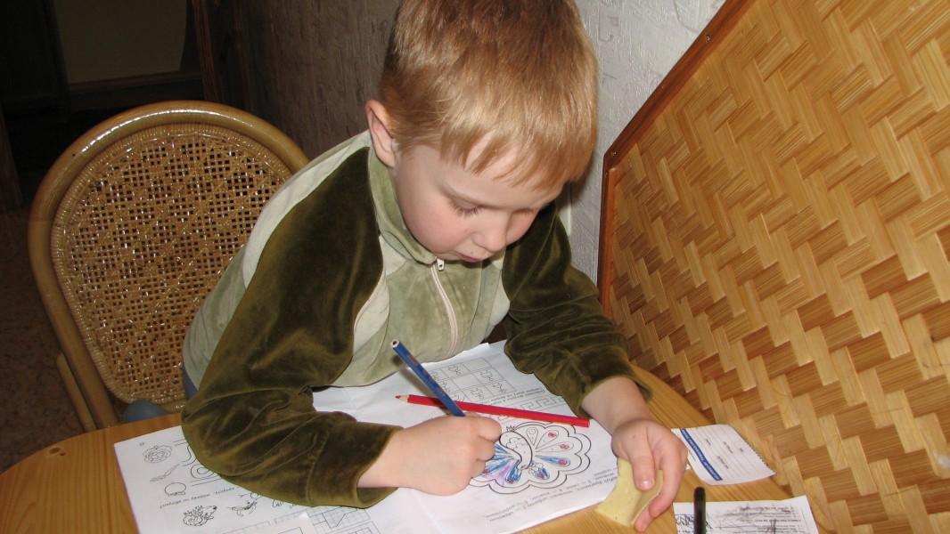 A small boy doing his first books