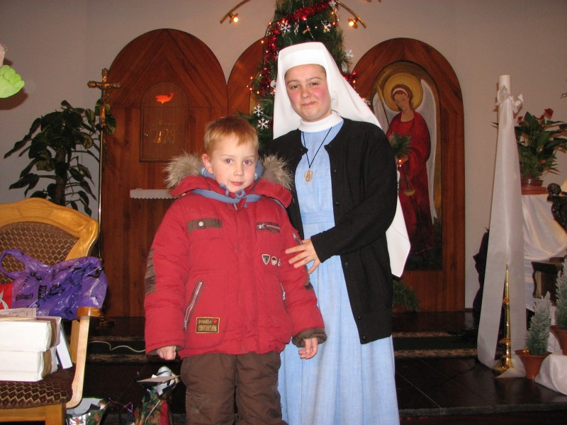 A Catholic nun with a small boy