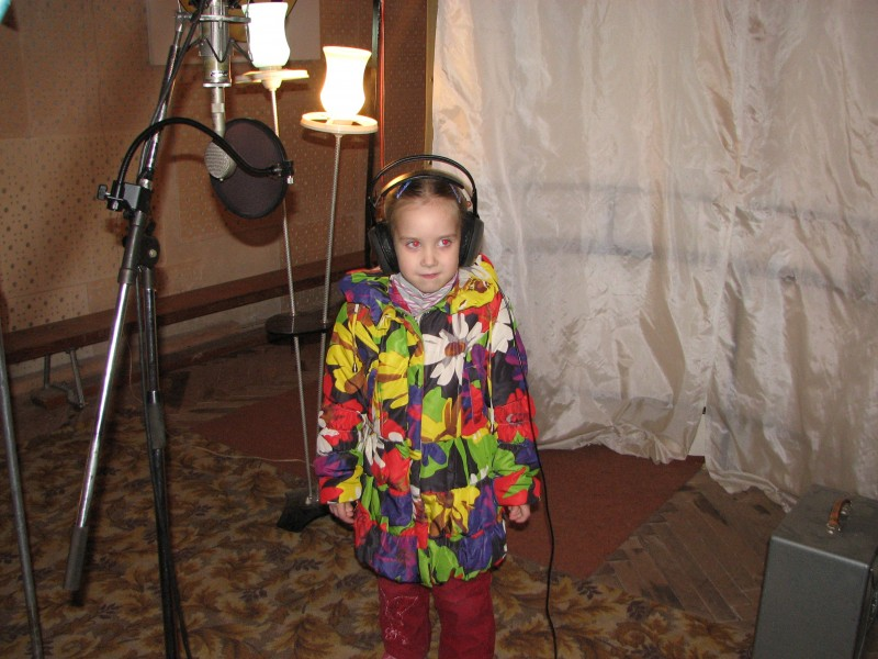 A Catholic girl in a record studio in Lviv, Ukraine - recording a Christian music CD, picture 6.