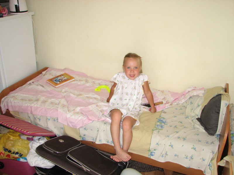A small girl in a hotel on the seaside.