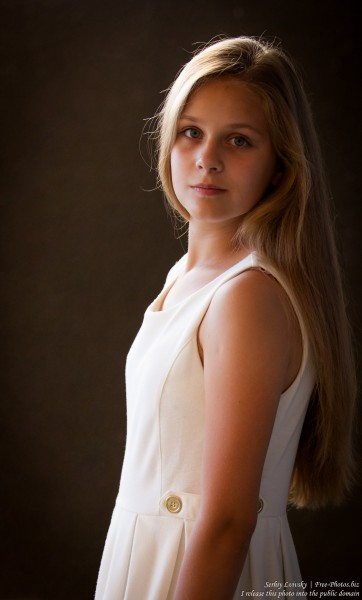a 12-year-old blond girl wearing a white dress photographed in July 2015 by Serhiy Lvivsky, picture 3