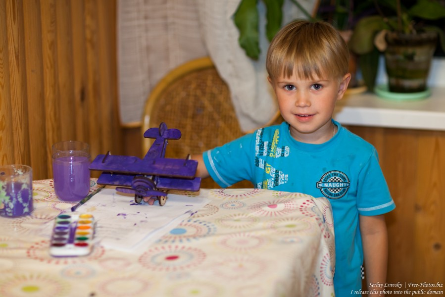 a 4-year-old boy with his newly-painted airplane in August 2017