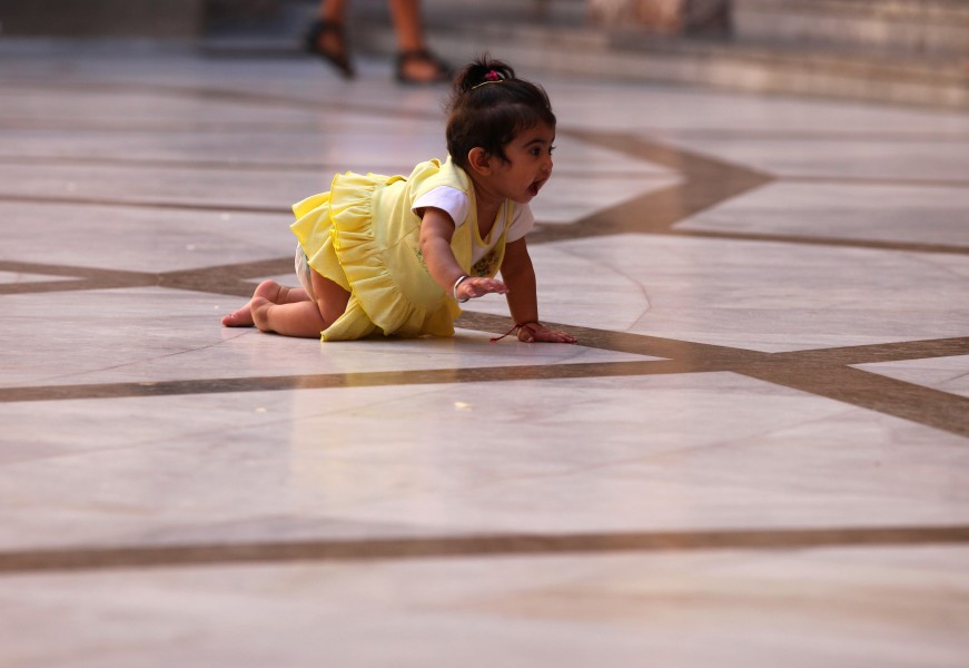 a baby girl crawling in Montserrat sanctuary, Catalonia, Spain, August 2013, photo 2