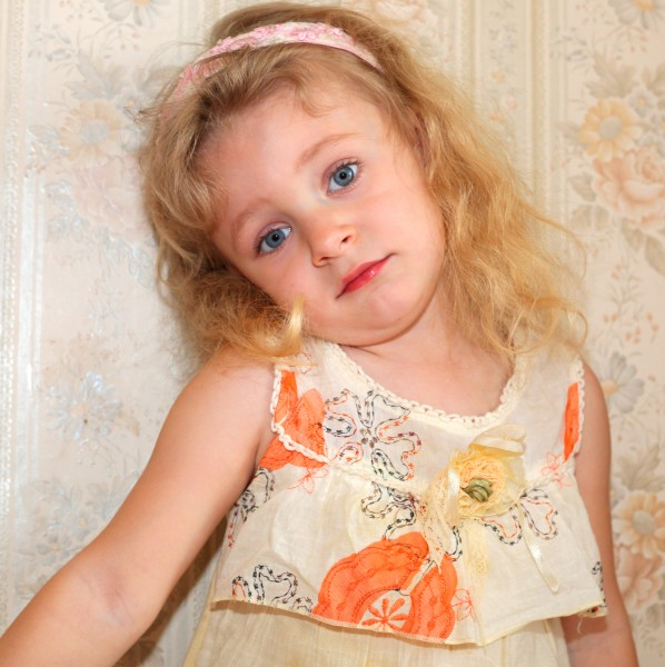 a sweet blond child girl photographed in May 2013, picture 26