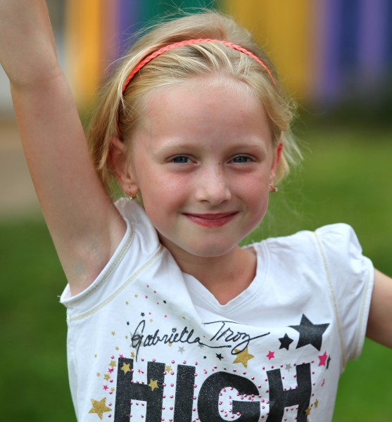 a blond beautiful young charming girl (a Catholic Christian) in a Christian camp in July 2013, picture 1/8