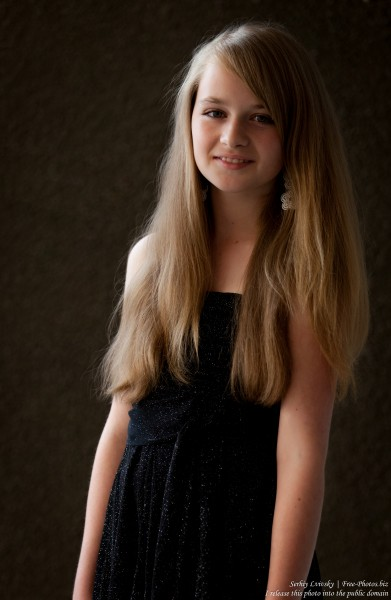 a blond 13-year-old girl photographed in June 2015, picture 4