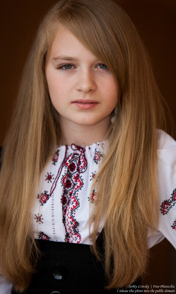 a blond 13-year-old girl photographed in June 2015, picture 12