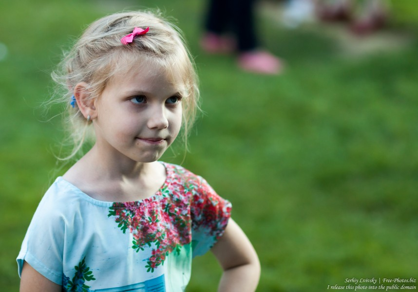 a child girl at Catholic recollections in Poland in July 2017, picture 2