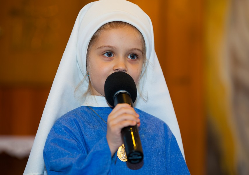 a child girl playing a role of a nun in a Catholic kindergarten in November 2013