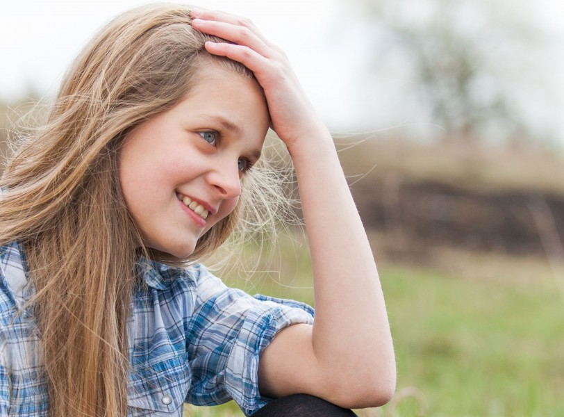 a cute blond 12-year-old girl photographed in April 2015, picture 3
