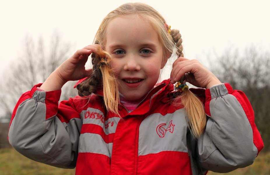 a cute blond 6-year-old Catholic girl with pigtails, picture 1