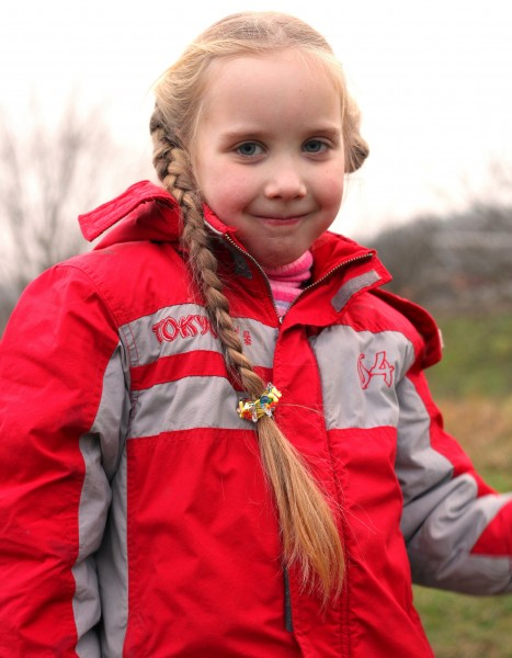 a cute blond 6-year-old Catholic girl with a pigtail, photo 2