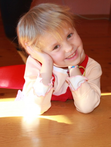 a portrait of a cute blond smiling charming Catholic child girl, photo 3