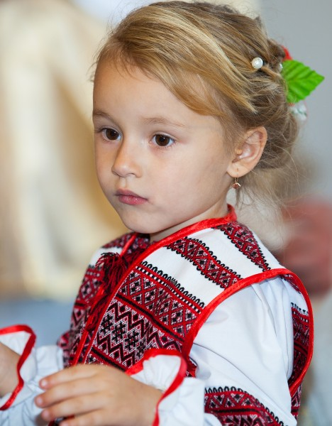 a cute blond child girl in a Catholic kindergarten photographed in November 2013, picture 1