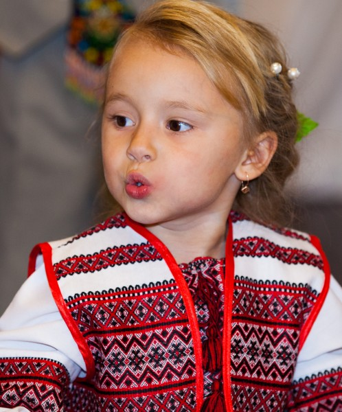 a cute blond child girl in a Catholic kindergarten photographed in November 2013, picture 3