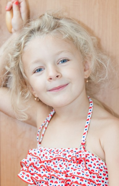 a cute blond child girl photographed in August 2014, picture 1