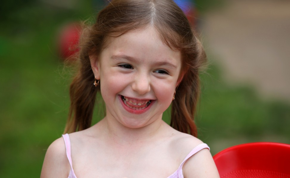 a cute smiling brunette child girl in a Christian camp in July 2013, portrait 1/7