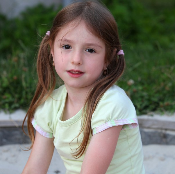 a cute brunette child girl in a Catholic camp in July 2013, portrait 2/7