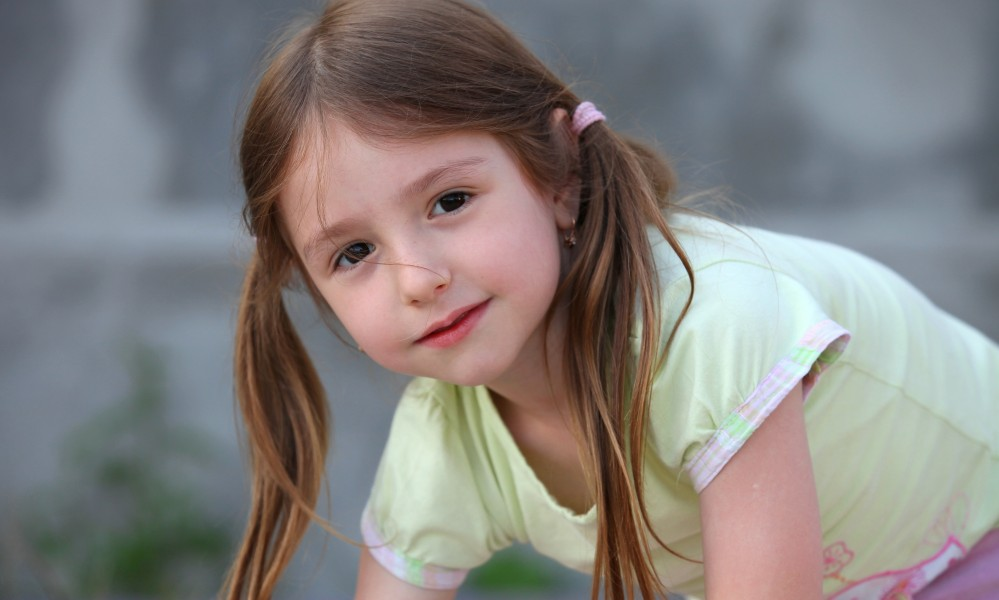 a cute brunette child girl in a Christian camp in July 2013, portrait 3/7