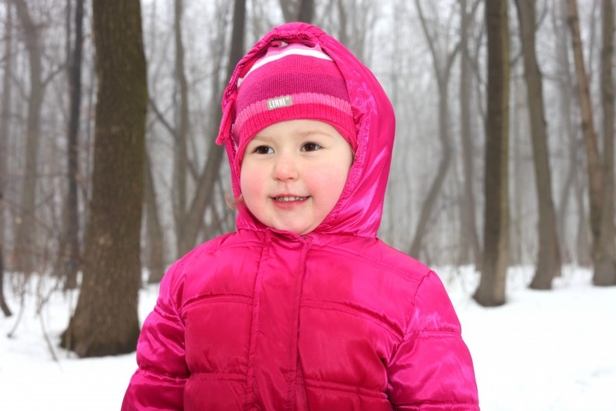 a cute Catholic child girl in a foggy forest, photo 1