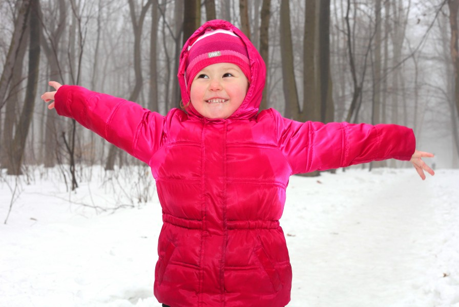 a cute Catholic child girl in a foggy forest, photo 3