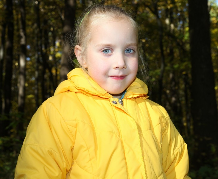 a cute blond Catholic child girl with grey eyes, in a forest, picture 4