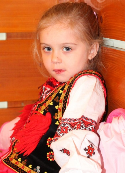 a cute charming beautiful Catholic child girl in a Church, photo 2